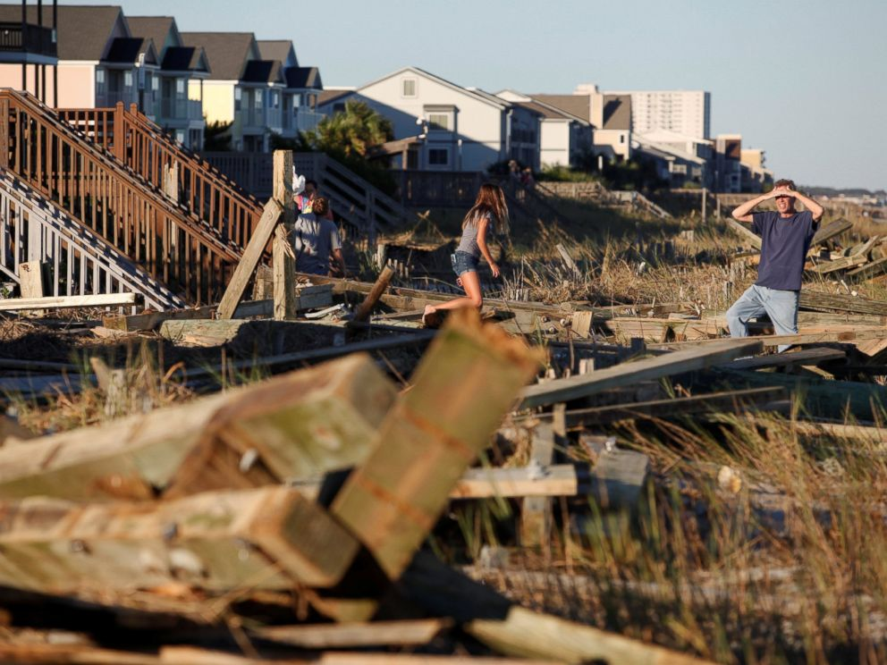 PHOTO: People look through the debris from the pier damaged by Hurricane Matthew in Surfside Beach, South Carolina, Oct. 9, 2016.