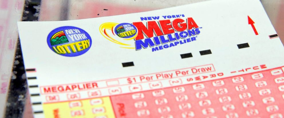 PHOTO: A ticket is seen ahead of the Mega Millions lottery draw which reached a jackpot of $449 Million in New York City, July 1, 2016.