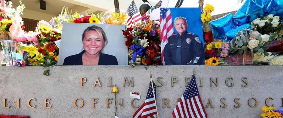 PHOTO: The photographs of slain Palm Springs Police Officers Lesley Zerebny (L) and Jose Vega are shown amidst flowers and remembrances atop a memorial statue at police headquarters in Palm Springs, California, on Oct. 9, 2016.