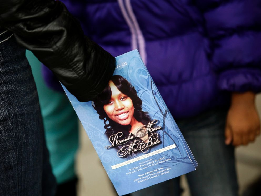 PHOTO: A mourner holds an obituary displaying a picture of shooting victim Renisha McBride during her funeral service in Detroit, Mich., Nov. 8, 2013.