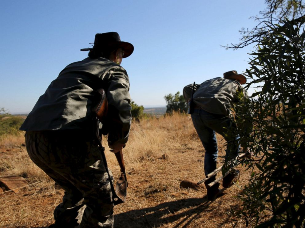 PHOTO: Professional hunters react during a hunt for game at the Iwamanzi Game Reserve in Koster, in the North West Province, June 6, 2015.