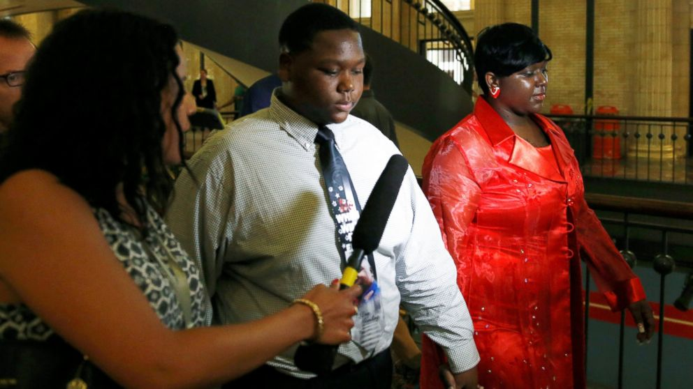 Cameron Sterling, son of Alton Sterling who was killed by police in Baton Rouge, Louisiana, arrives with his mother Quinyetta McMillan, right, at Union Station in Washington, July 14, 2016.