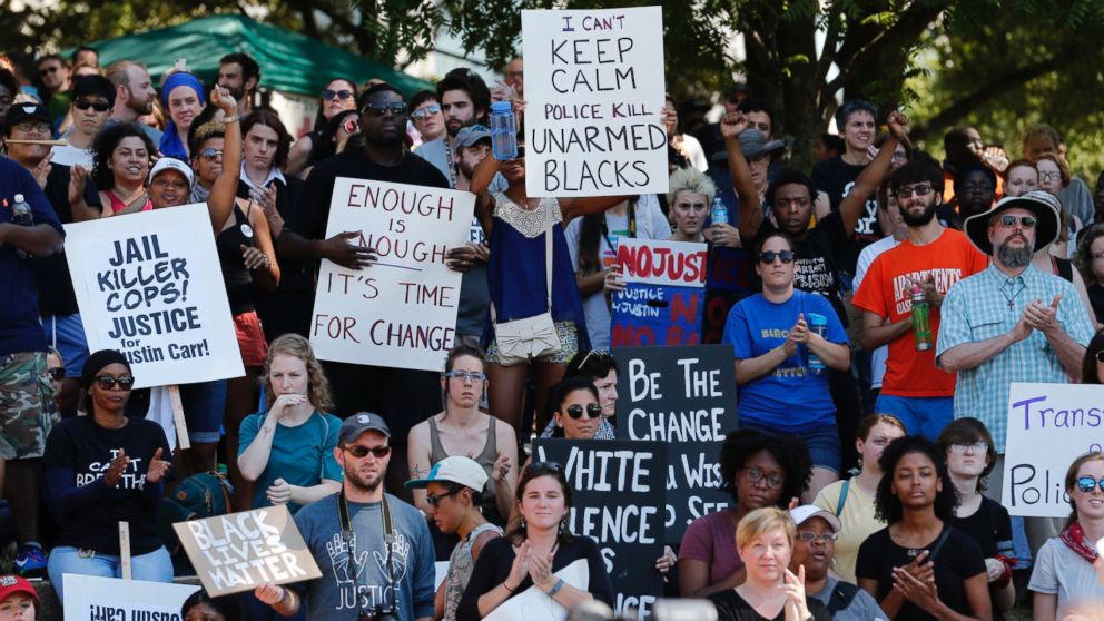 People cheer at a rally at Marshall Park to protest the police shooting of Keith Scott, in Charlotte, North Carolina, Sept. 24, 2016.