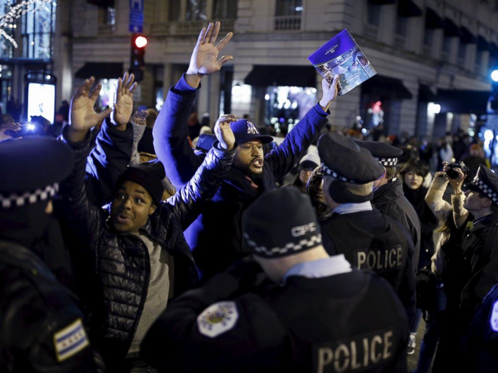 PHOTO: Demonstrators confront police officers during a protest in reaction to the fatal shooting of Laquan McDonald in Chicago, Nov. 27, 2015. Laquan McDonald, 17, was fatally shot by Jason Van Dyke, a Chicago police officer, in October 2014.