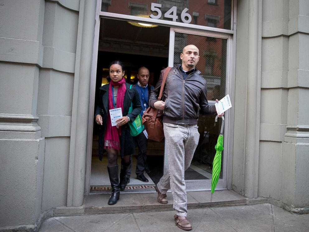 PHOTO: Members of the New York City Department of Health exit the building of a Health Care worker who is suspected to have Ebola in in the Harlem section of New York, Oct. 23, 2014.