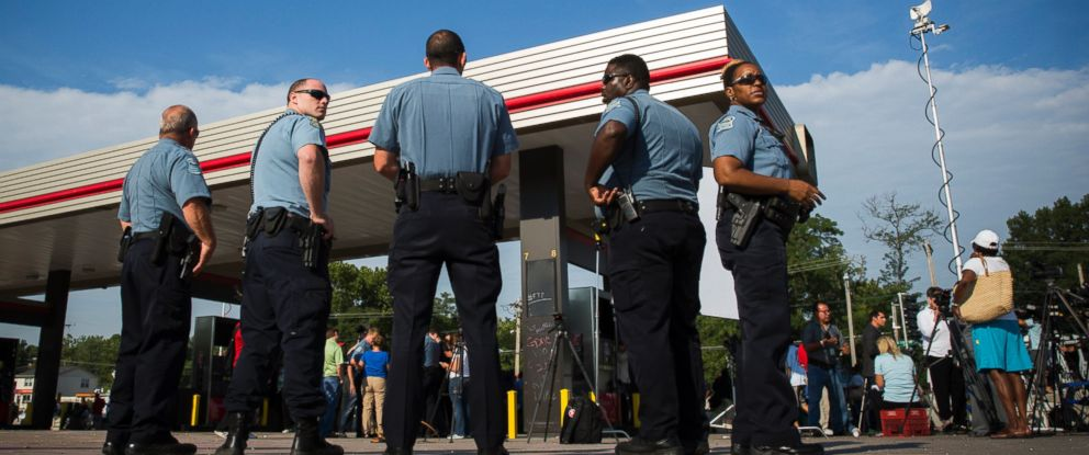 PHOTO: Police officers stand by in Ferguson, Missouri, Aug. 15, 2014