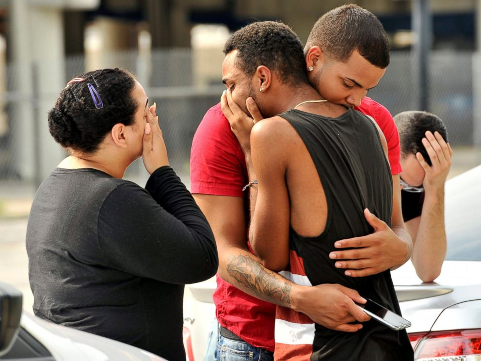 PHOTO: Friends and family members embrace outside the Orlando Police Headquarters during the investigation of a shooting at the Pulse night club, after a gunman opened fire, in Orlando, Fla., June 12, 2016.