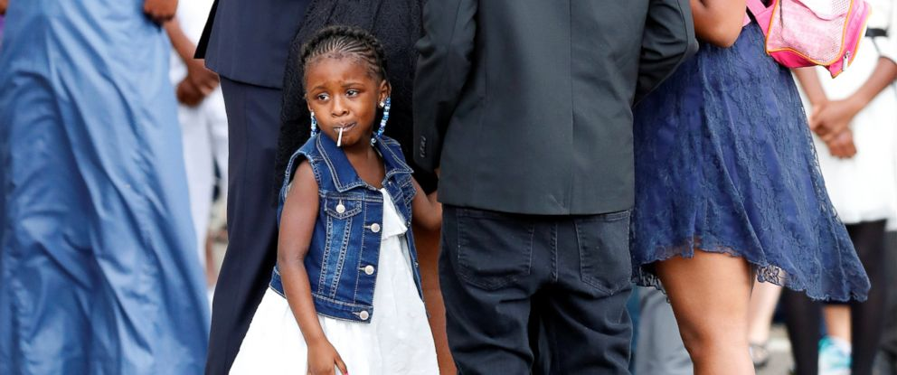 PHOTO: Diamond Reynolds daughter looks on as the funeral procession for Philando Castile travels from the Brooks funeral home to the St Paul Cathedral in St Paul, Minnesota, July 14, 2016.