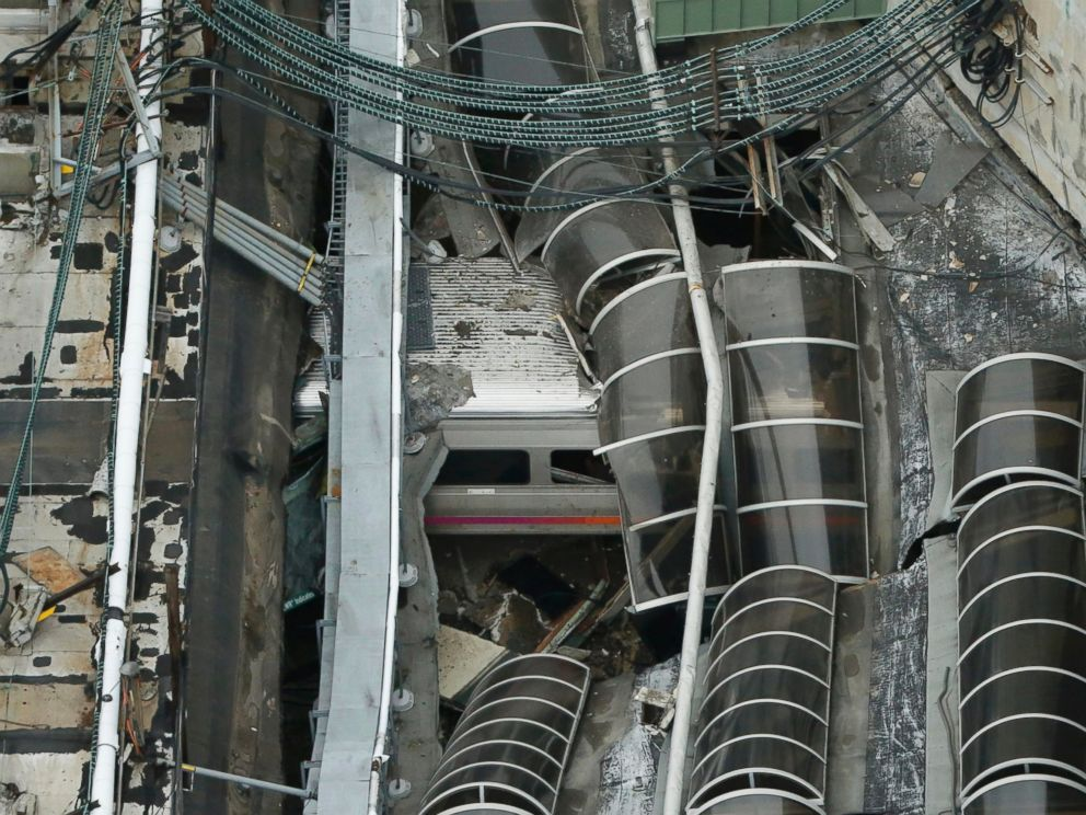 PHOTO: A derailed New Jersey Transit train is seen under a collapsed roof after it derailed and crashed into the station in Hoboken, New Jersey, Sept. 29, 2016.