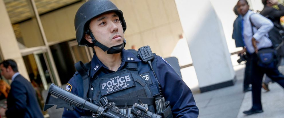 PHOTO: A NYPD Emergency Service Unit officer stands outside a news conference following a bi-state meeting on regional security and preparedness in New York, Sept. 15, 2014.