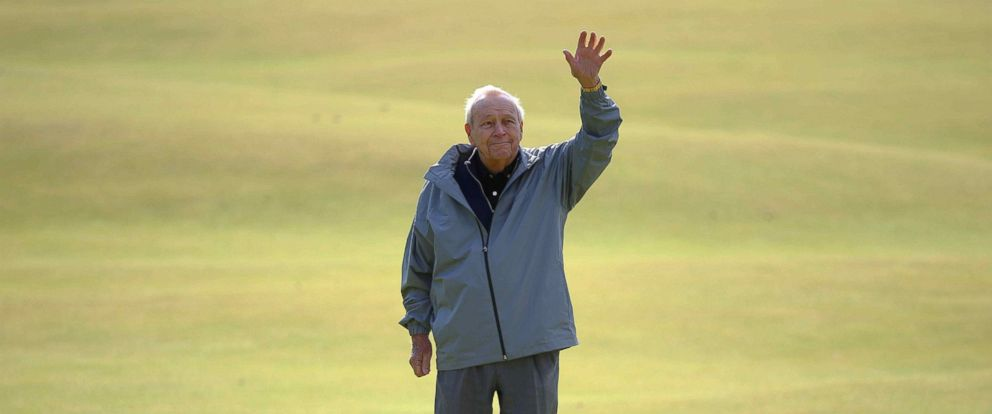 PHOTO: Arnold Palmer waves to the crowd as he stands on the 18th green during the Champion Golfers Challenge tournament ahead of the British Open golf championship on the Old Course in St. Andrews, Scotland in this July 15, 2015 file photo.