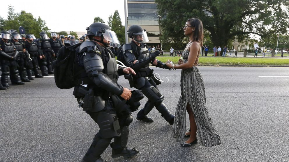 A demonstrator protesting the shooting death of Alton Sterling is detained by law enforcement near the headquarters of the Baton Rouge Police Department in Baton Rouge, Louisiana, July 9, 2016.