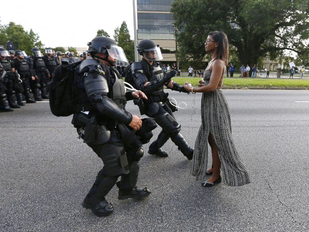 PHOTO: A demonstrator protesting the shooting death of Alton Sterling is detained by law enforcement near the headquarters of the Baton Rouge Police Department in Baton Rouge, Louisiana, July 9, 2016.