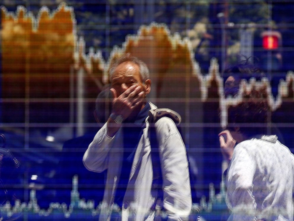 PHOTO: A man is reflected in an electronic board showing the graph of the recent fluctuations of the Tokyo Stock Price Index in Tokyo, June 27, 2016.