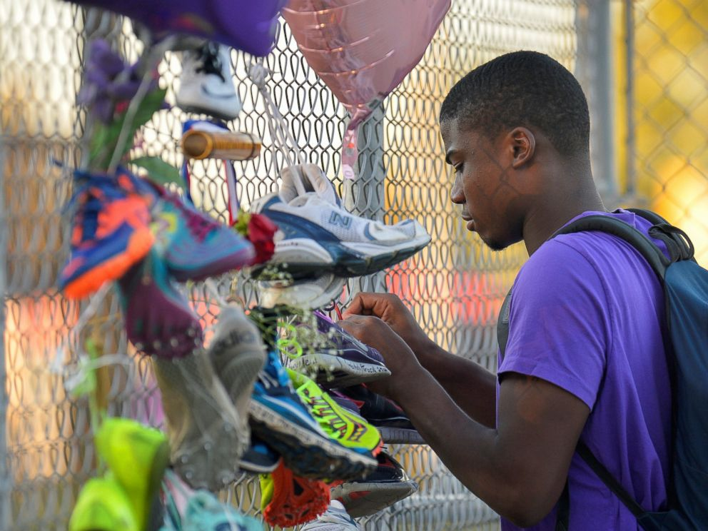 PHOTO: Darrell Ugboaga, 16, hangs his running shoes on a memorial for Trinity Gay, the daughter of Olympic sprinter Tyson Gay, who died in an exchange of gunfire early Sunday morning, in Lexington, Kentucky, Oct. 17, 2016.