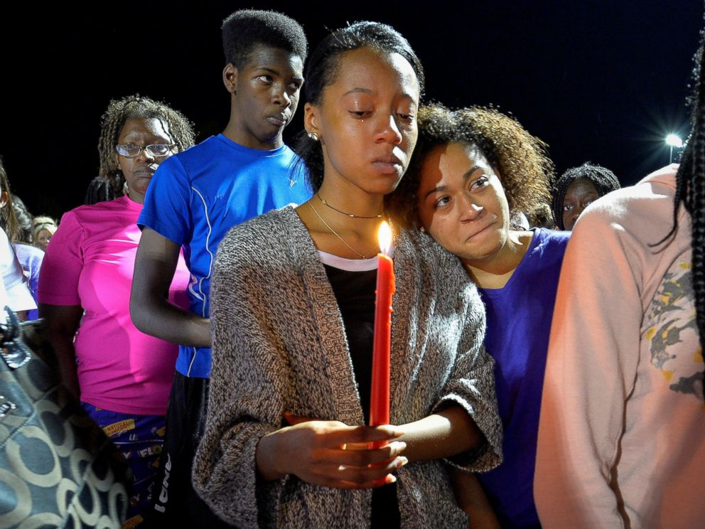 PHOTO: People gather during a candlelight vigil at Lafayette High School for Trinity Gay, the daughter of Olympic sprinter Tyson Gay, who died in an exchange of gunfire early Sunday morning, in Lexington, Kentucky, Oct. 17, 2016.