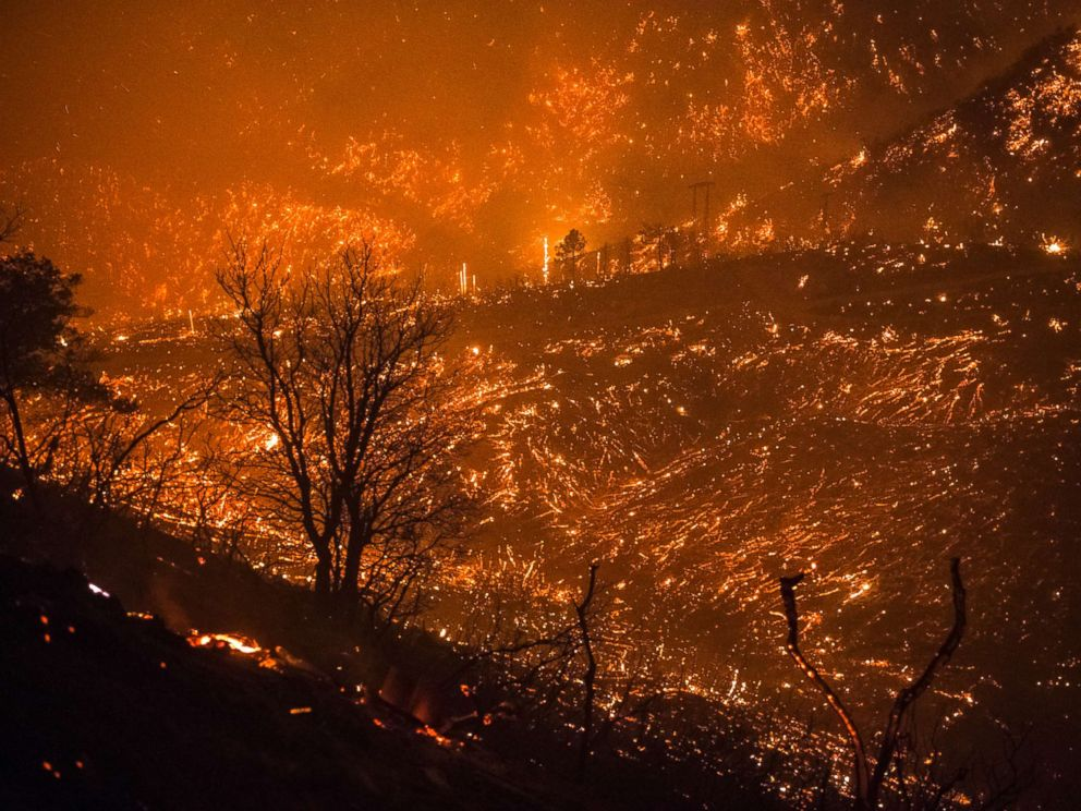 PHOTO: The foothills of the Santa Ynez mountains glow shortly after the fire front of the Thomas Fire passed through Monday night on Dec. 11, 2017, in Montecito, Calif.