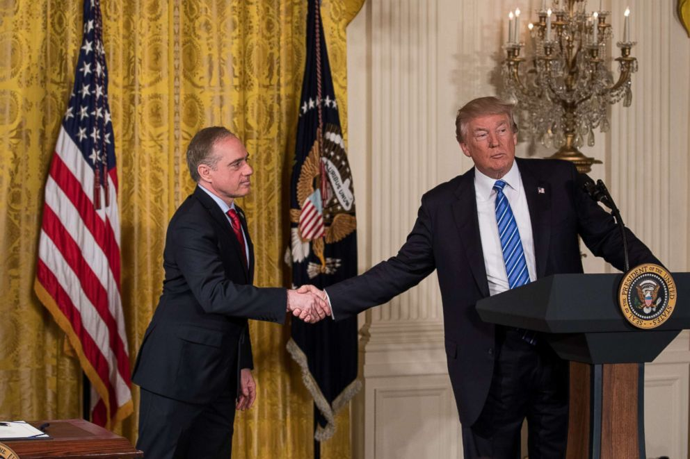 PHOTO: VA Secretary David Shulkin, and President Donald Trump shake hands, before President Trump signs the Department of Veterans Affairs Accountability and Whistleblower Protection Act of 2017 in the East Room of the White House, on June 23, 2017.