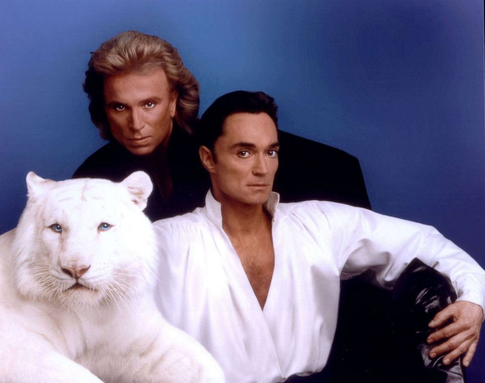 PHOTO:Siegfried & Roy pose with a white tiger in this undated photo.