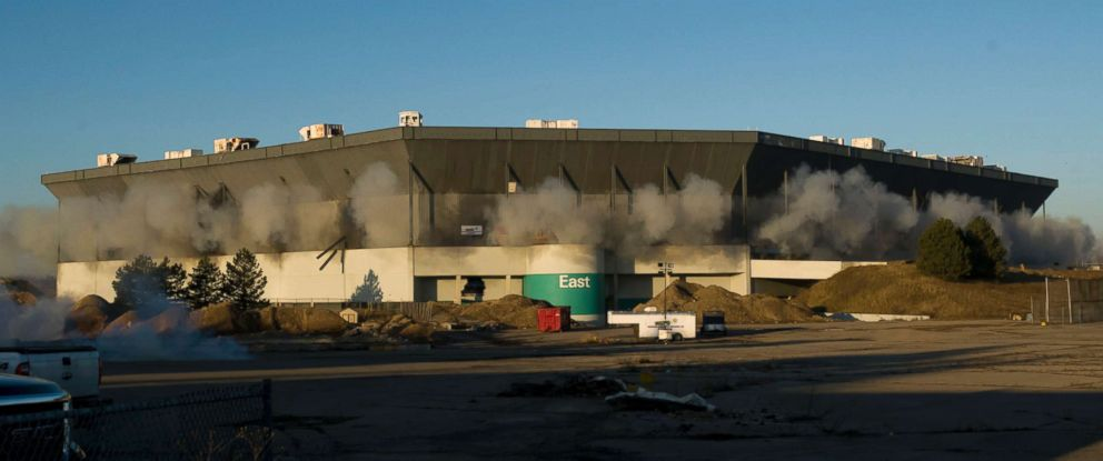PHOTO: Detonations can be seen during an attempted implosion of the Silverdome, in Pontiac, Mich., Dec. 3, 2017. Technical problems with the explosives left the stadium still standing after the blast.