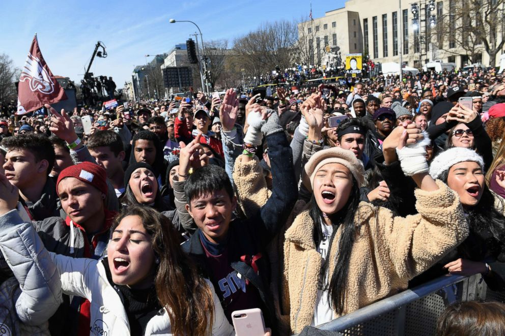 PHOTO: Marjory Stoneman Douglas High School students sing along to Miley Cyrus during the March for Our Lives protest march on March 24, 2018 in Washington.