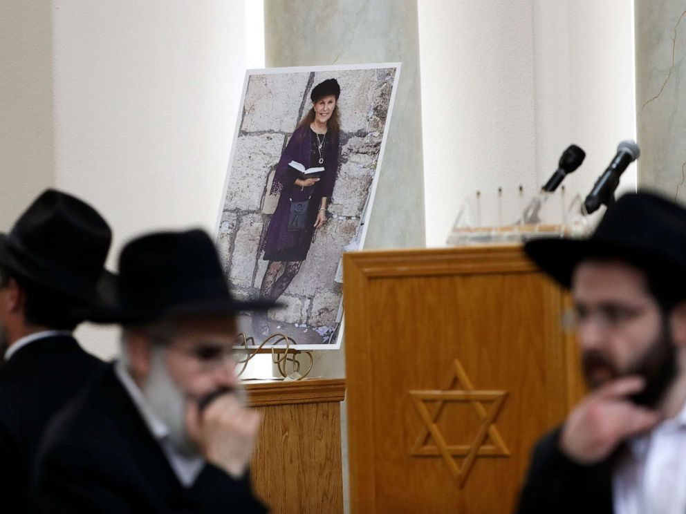 PHOTO: Attendees at the funeral for Lori Kaye, who was killed when a gunman opened fire inside the Chabad of Poway synagogue in Poway, Calif., pass by a photo of Kaye, April 29, 2019, inside the synagogue.