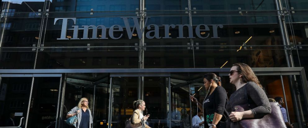 PHOTO: People walk past the Time Warner Center, June 12, 2018 in New York.