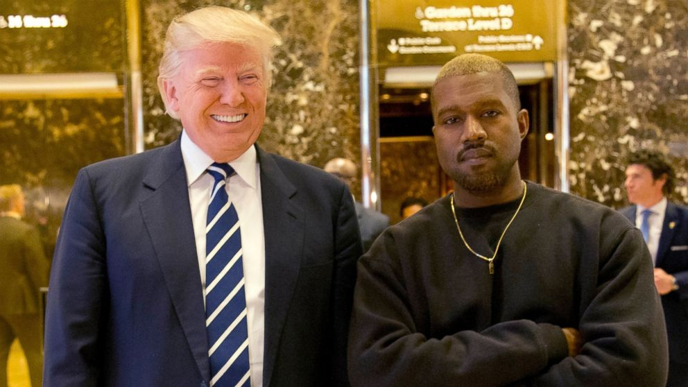 In this Dec. 13, 2016, file photo, President-elect Donald Trump and Kanye West pose for a picture in the lobby of Trump Tower in New York.
