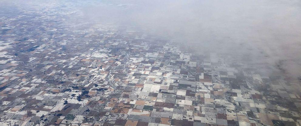 PHOTO: Snow covered farm fields make a quit-like patchwork near Bridgewater, South Dakota, U.S. November 8, 2019. (REUTERS/Jim Urquhart)
