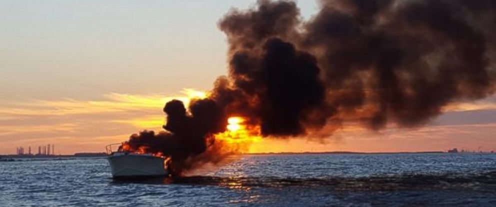 PHOTO: This photo provided by the United States Coast Guard shows a boat on fire. Some Good Samaritans helped rescue four passengers off the South Galveston Jetty in Texas on September 20, 2015.