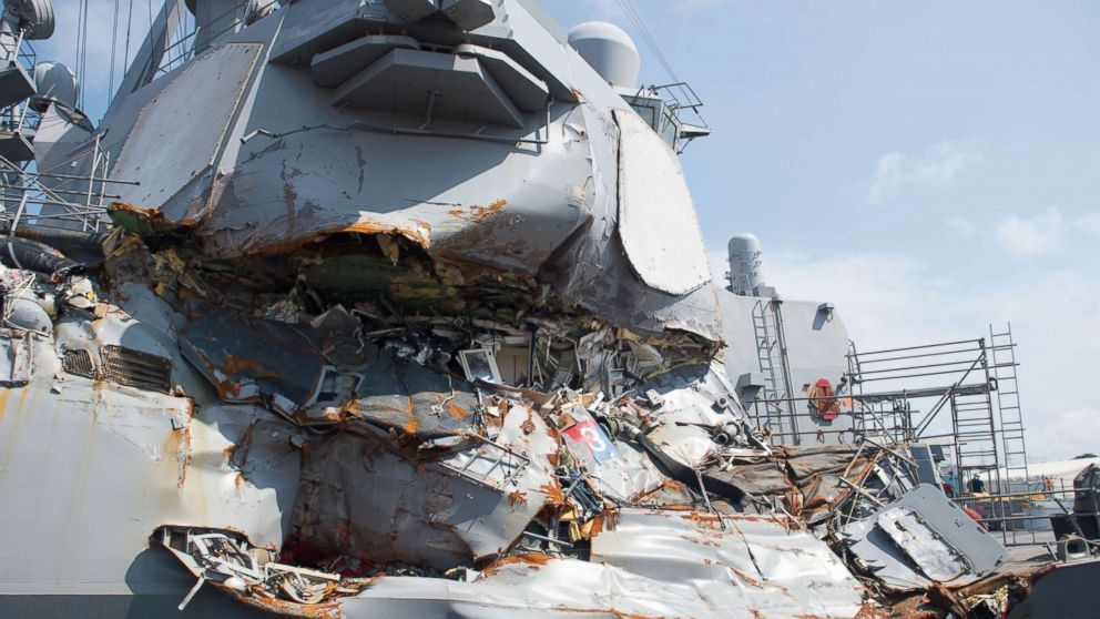 The USS Fitzgerald sits in Dry Dock 4 at Fleet Activities Yokosuka, Japan to continue repairs and assess damage sustained from its June 17, 2017 collision with a merchant vessel.
