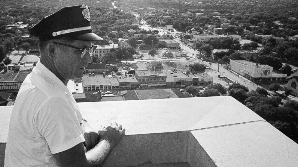 Sgt. Robert W. Turner, 50, of the University of Texas police, looks at the spot on the observation tower of the administration building where Charles J. Whitman was gunned down by police in Austin, Aug. 1, 1966.  Whitman, a 28-year-old engineering student and Marine-trained sniper, opened fire from the clock tower killing 14 people.