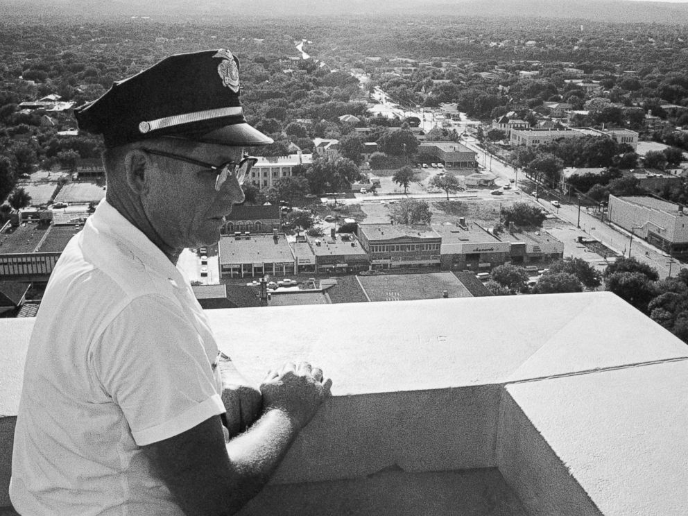 PHOTO: Sgt. Robert W. Turner, 50, of the University of Texas police, looks at the spot on the observation tower of the administration building where Charles J. Whitman was gunned down by police in Austin, Aug. 1, 1966.