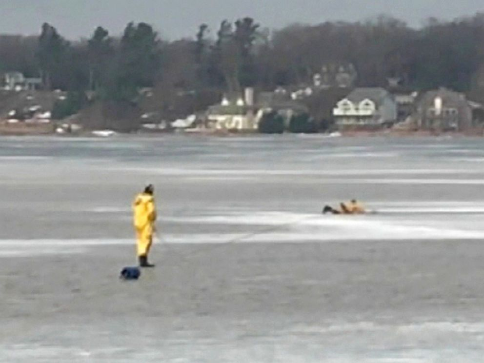 PHOTO: Two firemen from the White Lake Fire Dept. make their way out on the ice in an effort to rescue a dog that had fallen through the ice.