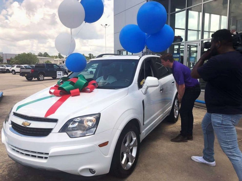 PHOTO: Anita Singleton, a cashier at a Walmart in Slidell, La., sits in the Chevrolet Captiva she was presented with on May 22, 2019, after the community found out she often walks six miles to work.