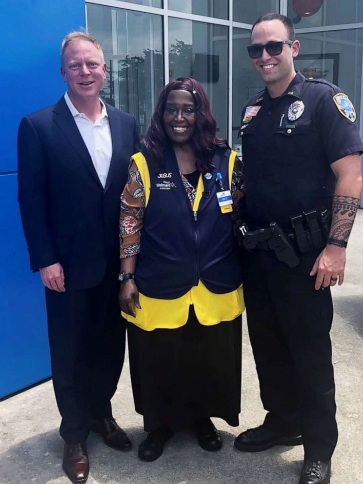 PHOTO: Chevrolet dealership owner Matt Bowers, Walmart cashier Anita Singleton and Slidell Police officer Brad Peck are pictured after Singleton, who would walk six miles to work, was presented with a new car on May 22, 2019.