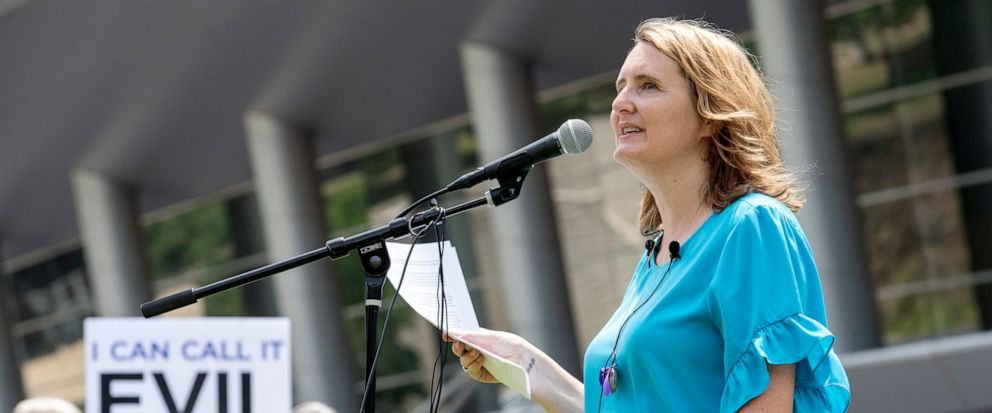 FILE - In this Tuesday, June 12, 2018 file photo, rape survivor and abuse victim advocate Mary DeMuth speaks during a rally protesting the Southern Baptist Conventions treatment of women outside the conventions annual meeting at the Kay Bailey Hutc