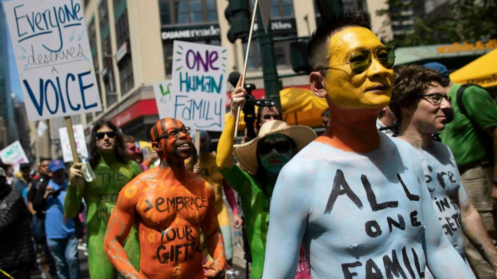 Protesters strip, get painted in Times Square thumbnail