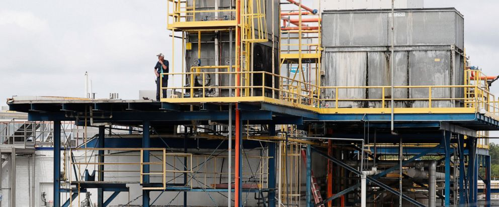 A plant employee stands near a refrigeration unit as business continues at this Koch Foods Inc., plant in Morton, Miss., Thursday, Aug. 8, 2019, following Wednesdays raid by U.S. immigration officials. In an email Thursday, U.S. Immigration and Cust