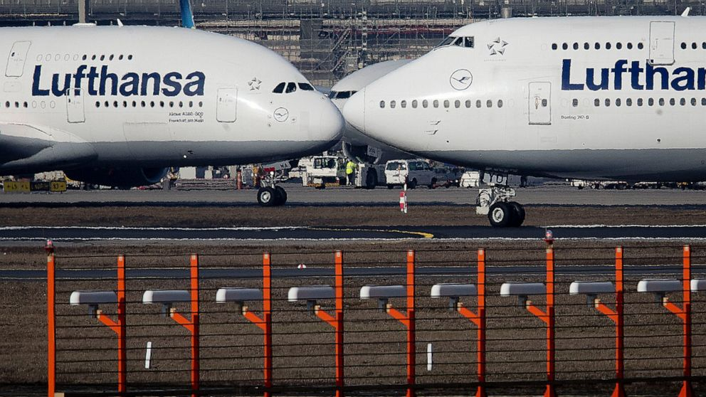 FILE - In this Feb.14, 2019 file photo, an Airbus A380, left, and a Boeing 747, both from Lufthansa airline pass each other at the airport in Frankfurt, Germany. The United States and the European Union on Tuesday appeared close to clinching a deal t