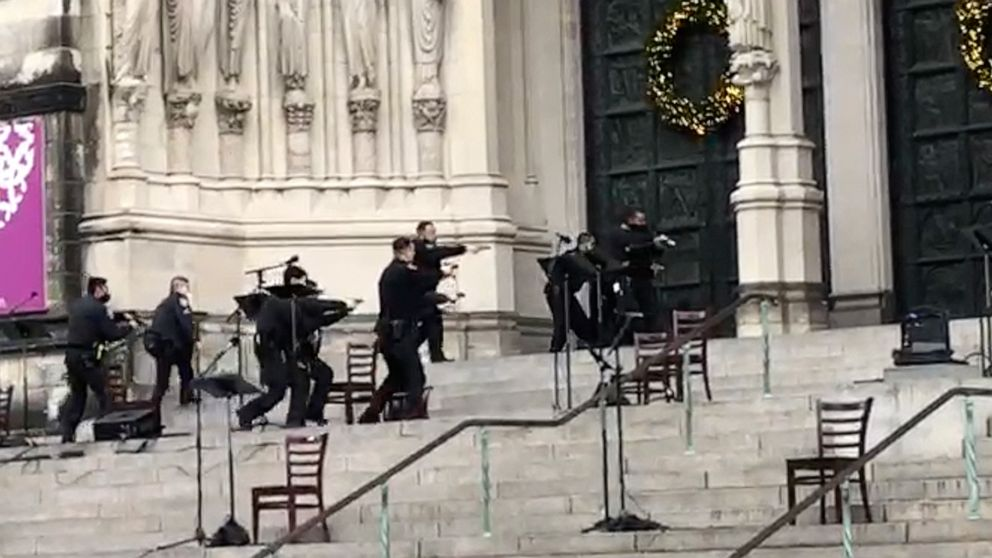 Gunman shot by police at NYC cathedral Christmas concert   ABC News