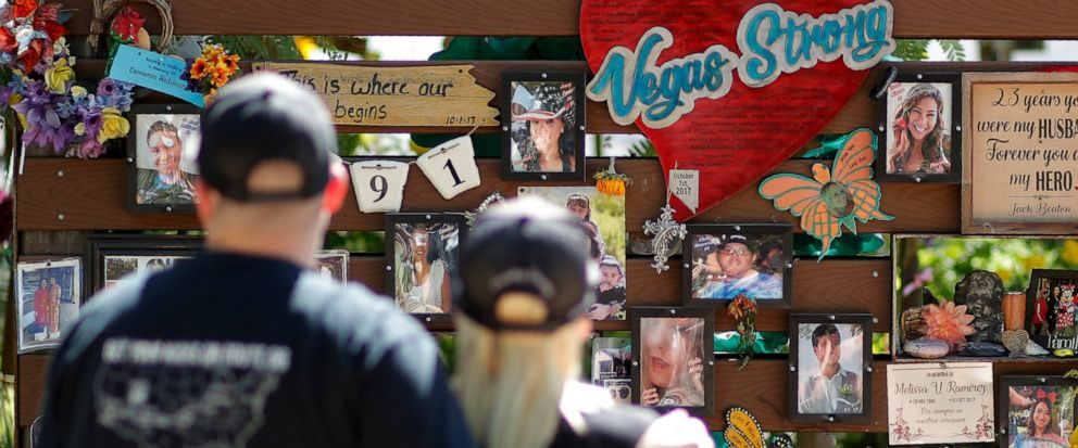 People visit a memorial garden for victims of a mass shooting in Las Vegas, Thursday, Oct. 3, 2019, in Las Vegas. Two years after a shooter rained gunfire on country music fans from a high-rise Las Vegas hotel, MGM Resorts International reached a set