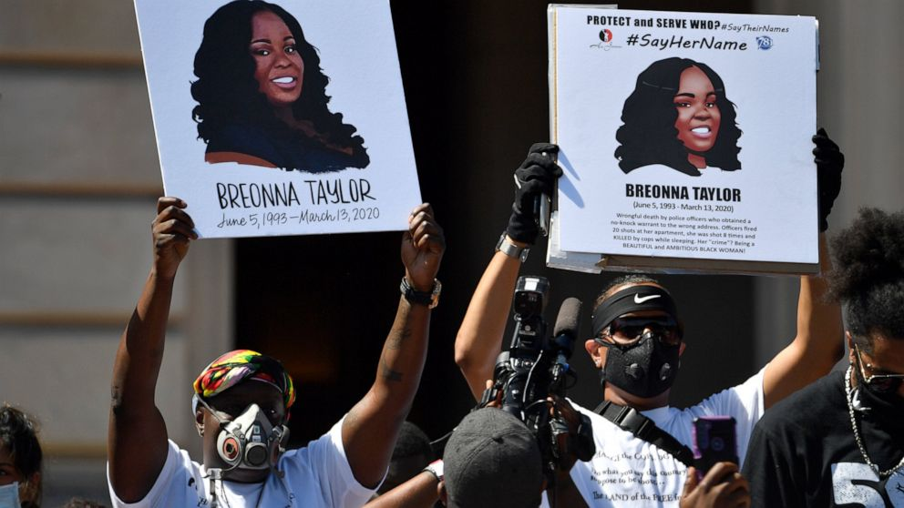 Signs are held up showing Breonna Taylor during a rally in her honor on the steps of the Kentucky State Capitol in Frankfort, Ky., Thursday, June 25, 2020. The rally was held to demand justice in the death of Taylor who was killed in her apartment by members of the Louisville Metro Police Department on March 13, 2020. (AP Photo/Timothy D. Easley)Signs are held up showing Breonna Taylor during a rally in her honor on the steps of the Kentucky State Capitol in Frankfort, Ky., Thursday, June 25, 2020. The rally was held to demand justice in the death of Taylor who was killed in her apartment by members of the Louisville Metro Police Department on March 13, 2020. (AP Photo/Timothy D. Easley) The Associated Press