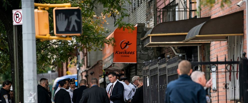 NYPD investigates the scene of a shooting in the Brooklyn borough of New York on Saturday, Oct. 12, 2019. Authorities responded to a call about shots fired just before 7 a.m. and found four men dead in the Crown Heights neighborhood of Brooklyn at an