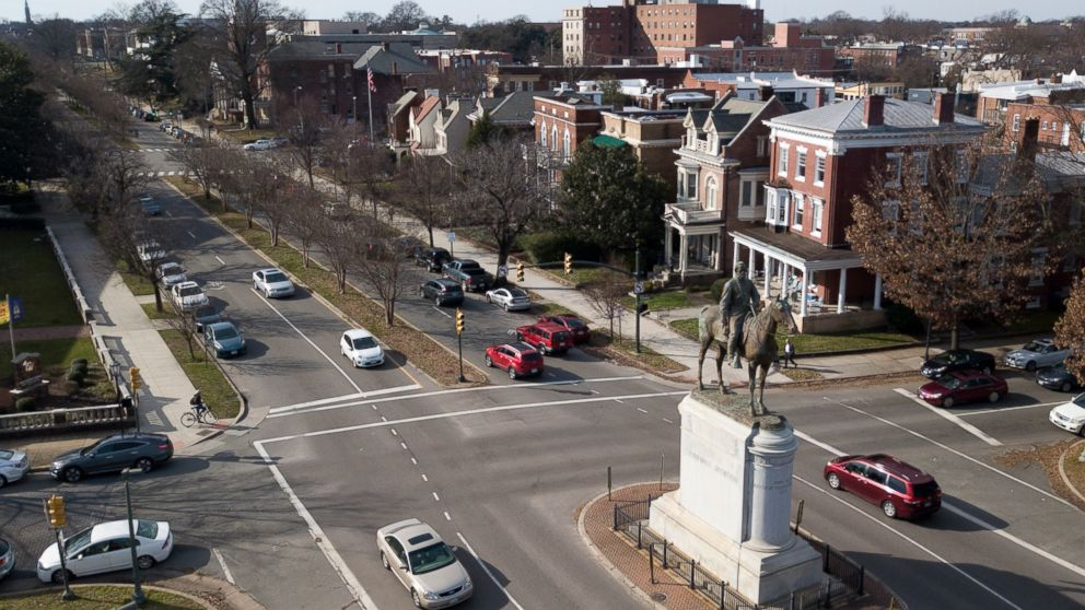 In this Jan. 27, 2019, traffic passes by the statue of Confederate General Stonewall Jackson at the intersection Traffic passes by the statue of Confederate General Stonewall Jackson at the intersection of Monument Avenue and The Boulevard in Richmond, Va. A city councilwoman and others are attempting to get the Boulevard named after tennis star Arthur Ashe. (AP Photo/Steve Helber)
