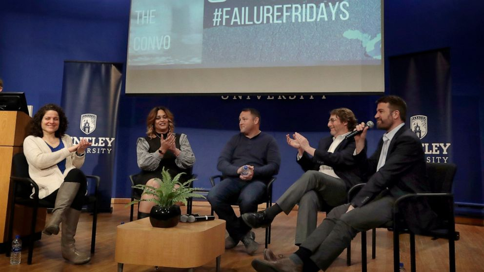"""In this March 5, 2019 photo, panel members, from left, Angela Giordano, Natalie Baucum, Mike Duggan, Fred Ledley and school counselor Peter Forkner participate in an event at Bentley University, in Waltham, Mass., where professors and alumni shared some of their worst setbacks to illustrate that even successful people sometimes fail. A growing number of U.S. colleges are trying to """"normalize"""" failure for a generation of students who increasingly struggle with stress, anxiety and the ability to bounce back from adversity. (AP Photo/Elise Amendola)"""