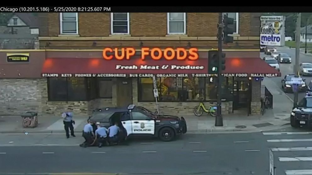 FILE - In this May 25, 2020 file image from surveillance video, Minneapolis police Officers from left, Tou Thao, Derek Chauvin, J. Alexander Kueng and Thomas Lane are seen attempting to take George Floyd into custody in Minneapolis, Minn. The video w