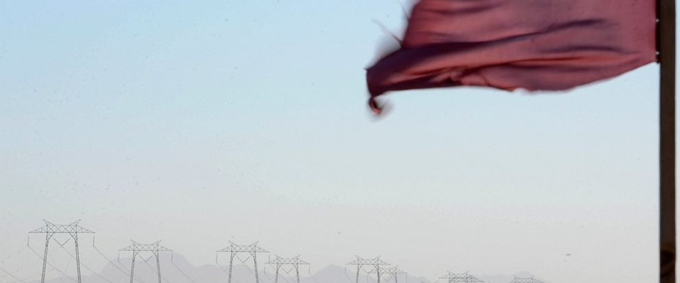 A wind whipped flag flies near a long row of transmission towers Wednesday, Oct. 9, 2019, in Richvale, Calif. Pacific Gas & Electric has cut power to more than half a million customers in Northern California hoping to prevent wildfires during dry, wi