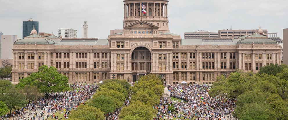 """FILE - In this March 24, 2018, file photo, thousands of people gather on the grounds of the Texas State Capitol during a """"March for Our Lives"""" rally in Austin, Texas. The vast majority of mass shooters have acquired their firearms legally with nothin"""