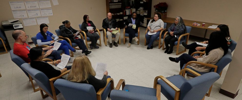 Annette Squetimkin-Anquoe, third from right, a member of the Colville Indian tribe and the Chief Traditional Health Officer at the Urban Indian Health Institute in Seattle, leads a talking circle meeting Friday, Jan. 11, 2019, to discuss the practice